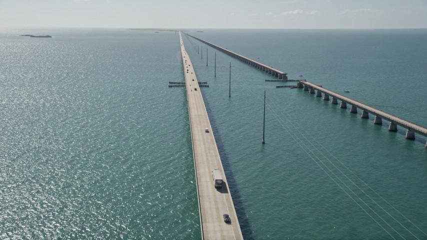 5K stock footage aerial video fly over Atlantic Ocean, reveal light traffic on Seven Mile Bridge, Florida Aerial Stock Footage | AX0026_023