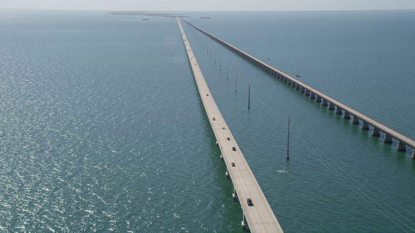 5K stock footage aerial video of following light traffic traveling on Seven Mile Bridge, Florida Aerial Stock Footage | AX0026_024