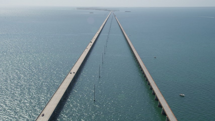 5K stock footage aerial video of passing by light traffic on the Seven Mile Bridge, Florida Aerial Stock Footage | AX0026_025