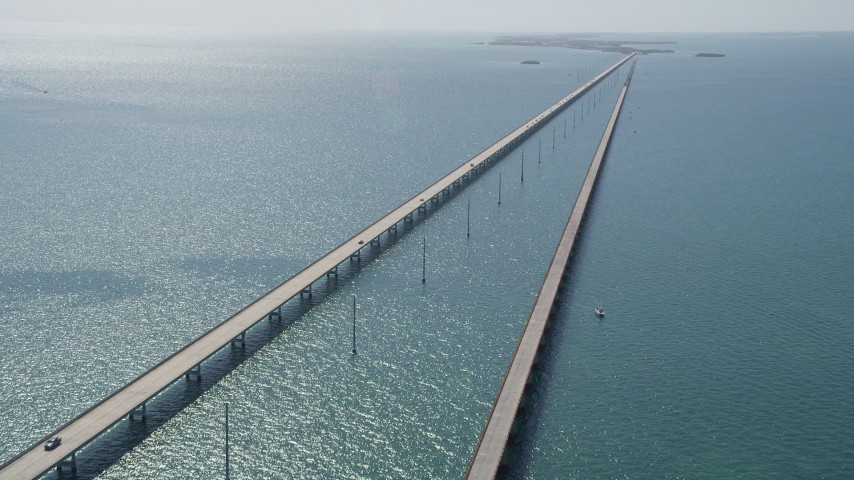 5K stock footage aerial video of approaching light traffic on the Seven Mile Bridge, Florida Aerial Stock Footage | AX0026_026
