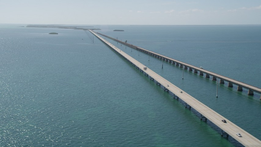 5K stock footage aerial video of following the bridge with light traffic, Seven Mile Bridge, Florida Aerial Stock Footage | AX0026_028