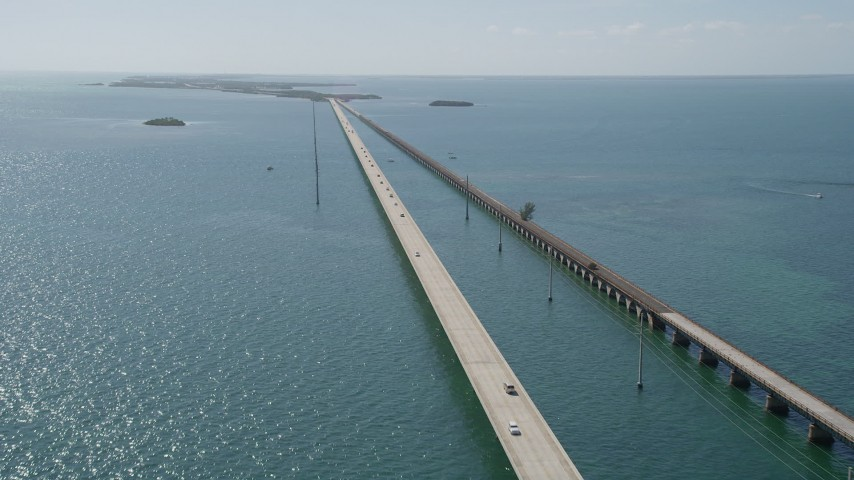 5K stock footage aerial video of cars crossing the Seven Mile Bridge, Florida Aerial Stock Footage | AX0026_029