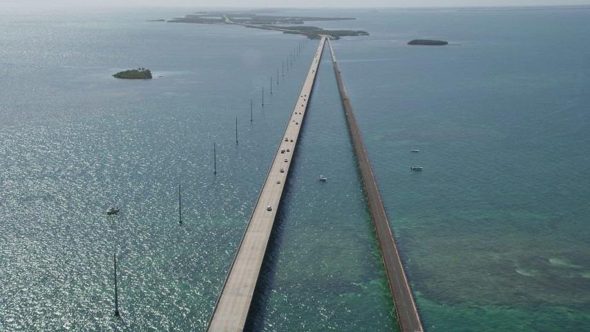 5K stock footage aerial video of tilting to light traffic on the Seven Mile Bridge, Florida Aerial Stock Footage | AX0026_030