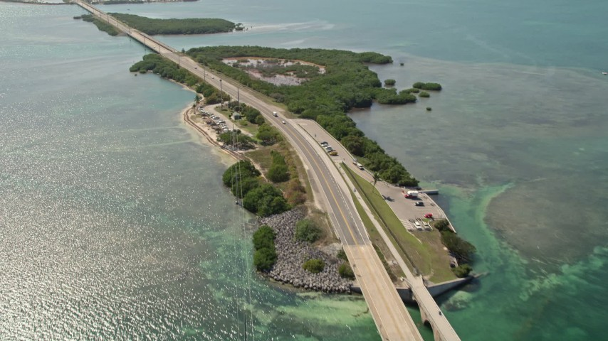 5K stock footage aerial video of flying by light traffic, revealing several Keys, Seven Mile Bridge, Florida Aerial Stock Footage | AX0026_032