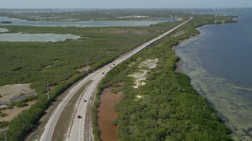 5K stock footage aerial video of flying over Overseas Highway at Big Pine Key, Florida Aerial Stock Footage | AX0026_046