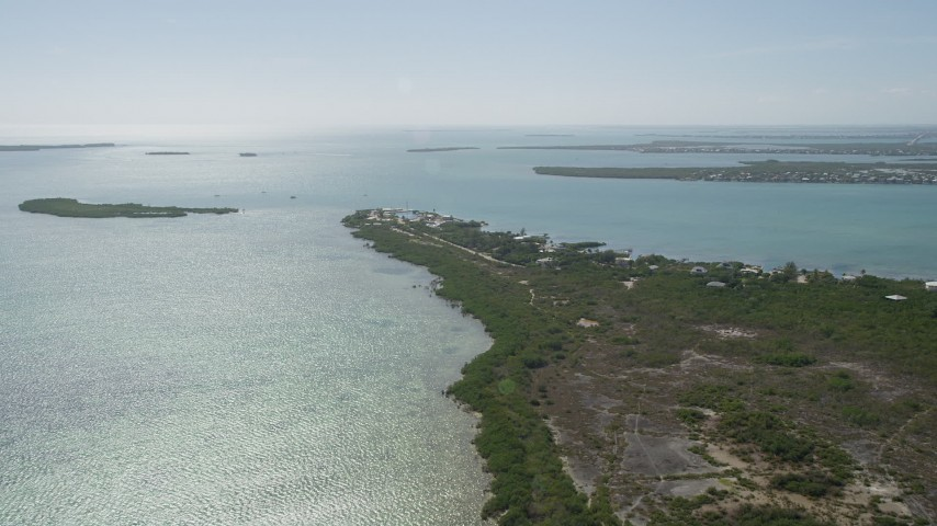 5K stock footage aerial video of approaching homes and small marina, Big Pine Key, Florida Aerial Stock Footage | AX0026_049