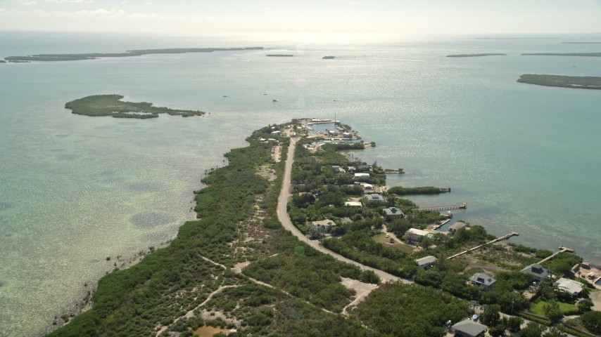 5K stock footage aerial video of approaching homes and small marina, Big Pine Key, Florida Aerial Stock Footage | AX0026_049E