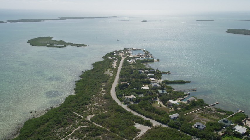 5K stock footage aerial video of flying by small marina on shore, Big Pine Key, Florida Aerial Stock Footage | AX0026_050
