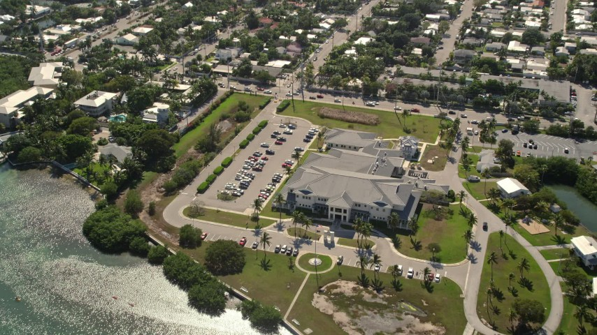 5K stock footage aerial video of approaching Key West VA Outpatient Clinic, Key West, Florida Aerial Stock Footage | AX0026_060