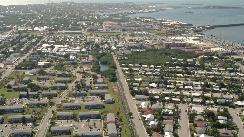 5K stock footage aerial video of flying over neighborhood, revealing Poinciana Mobile Home Park, Key West, Florida Aerial Stock Footage | AX0026_061