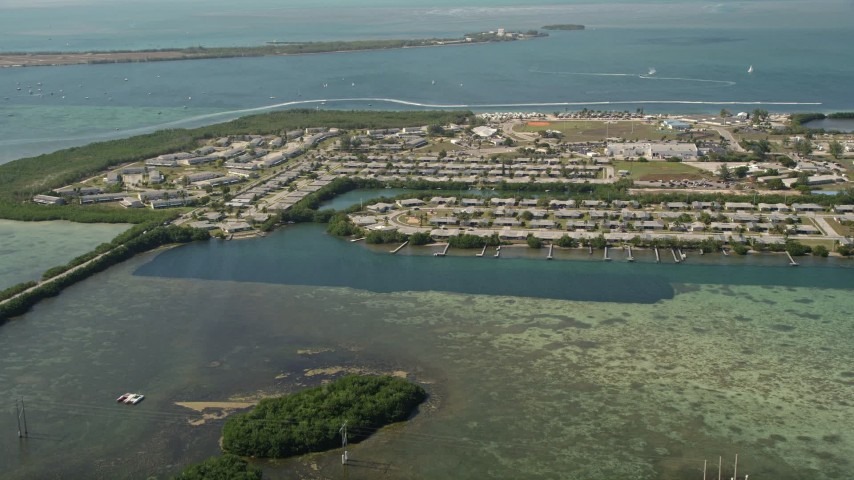5K stock footage aerial video of approaching military housing on Sigsbee Park shore, Key West, Florida Aerial Stock Footage | AX0026_063