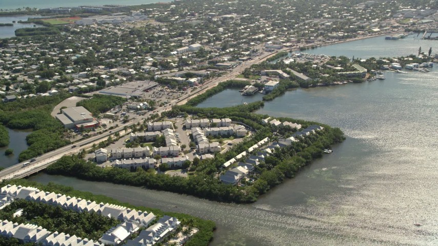 5K stock footage aerial video of flying by condominiums on the shore of Key West, Florida Aerial Stock Footage   AX0026_064