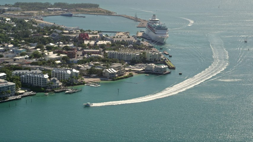5K stock footage aerial video fly by hotels on the shore, approach Royal Caribbean ship, Key West, Florida Aerial Stock Footage | AX0026_068