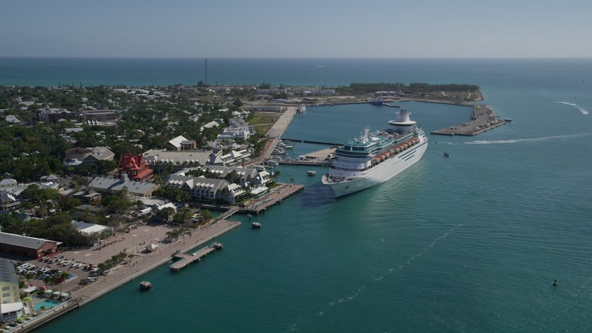 5K stock footage aerial video of flying by Royal Caribbean Cruise Ship docked in Key West, Florida Aerial Stock Footage   AX0026_069