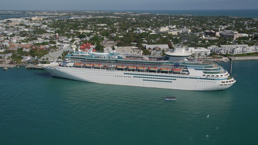 5K stock footage aerial video of flying by a Royal Caribbean Cruise Ship docked, Key West, Florida Aerial Stock Footage | AX0026_071