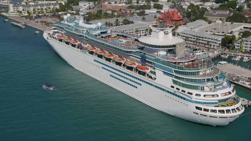 5K stock footage aerial video of approaching a Royal Caribbean Cruise Ship, docked, Key West, Florida Aerial Stock Footage | AX0026_072