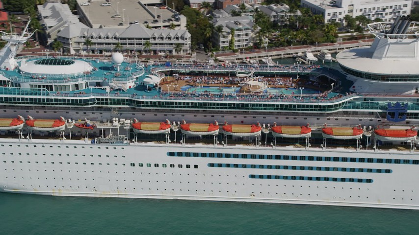 5K stock footage aerial video of flying by upper decks, pool area of Royal Caribbean Cruise Ship, Key West, Florida Aerial Stock Footage | AX0026_073