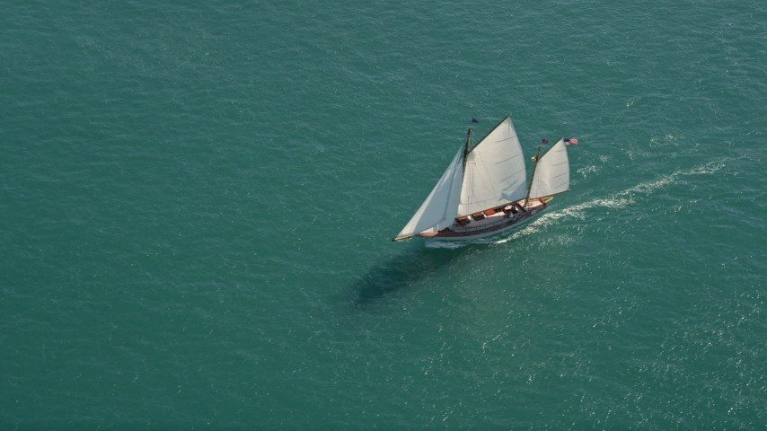 5K stock footage aerial video of a sailboat on the ocean near Key West, Florida Aerial Stock Footage | AX0026_075