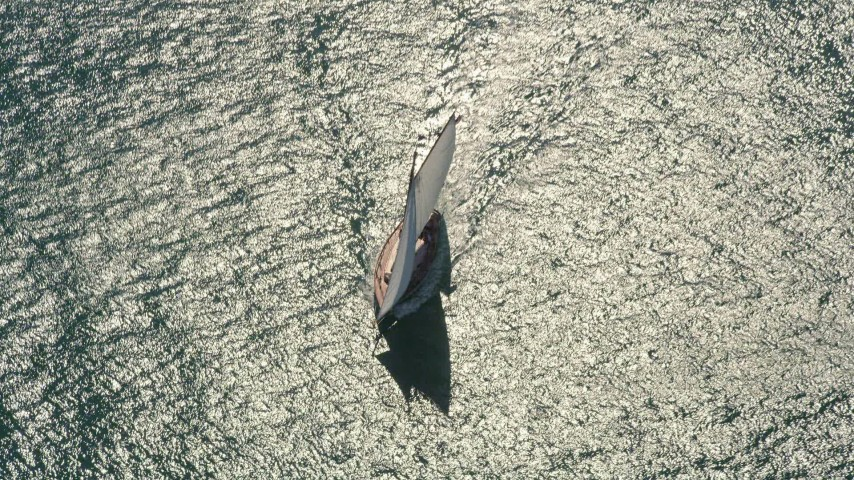 5K stock footage aerial video of a bird's eye view of a sailboat near Key West, Florida Aerial Stock Footage | AX0026_076