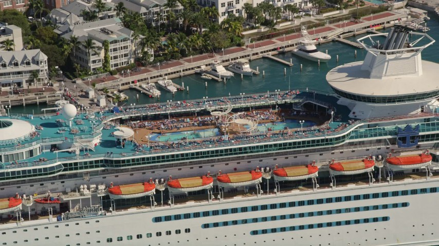 5K stock footage aerial video fly by sunbathers at pool on Royal Caribbean Cruise Ship, Key West, Florida Aerial Stock Footage   AX0026_078