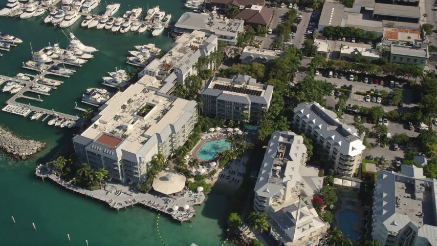 5K stock footage aerial video of flying over Pier House Resort and Caribbean Spa, Key West, Florida Aerial Stock Footage | AX0026_081