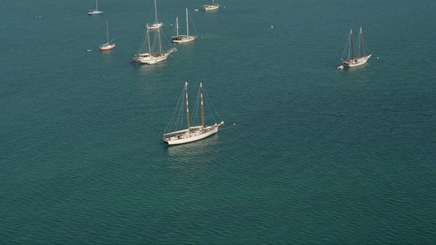 5K aerial  video of flying by sailboat moored off the shore of Key West, Florida Aerial Stock Footage | AX0026_085