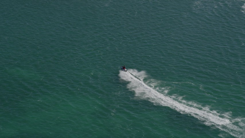5K stock footage aerial video of a jet skier cruising across the water in Key West, Florida Aerial Stock Footage | AX0026_090