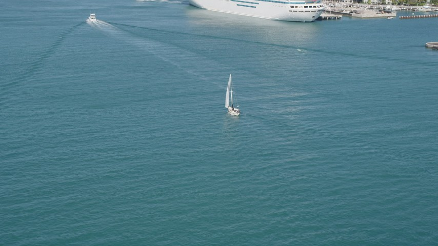 5K stock footage aerial video of following a sailboat near the shore of Key West, Florida Aerial Stock Footage | AX0026_096