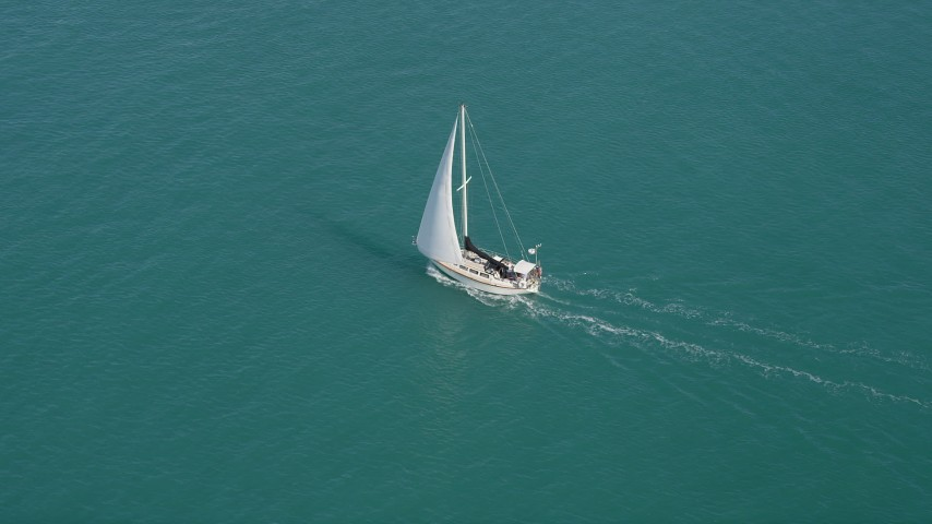 5K stock footage aerial video of orbiting a sailboat cruising across the water near Key West, Florida Aerial Stock Footage | AX0026_097