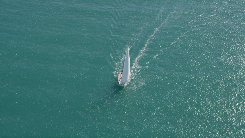 5K stock footage aerial video of circling a sailboat near Key West, Florida Aerial Stock Footage | AX0026_098