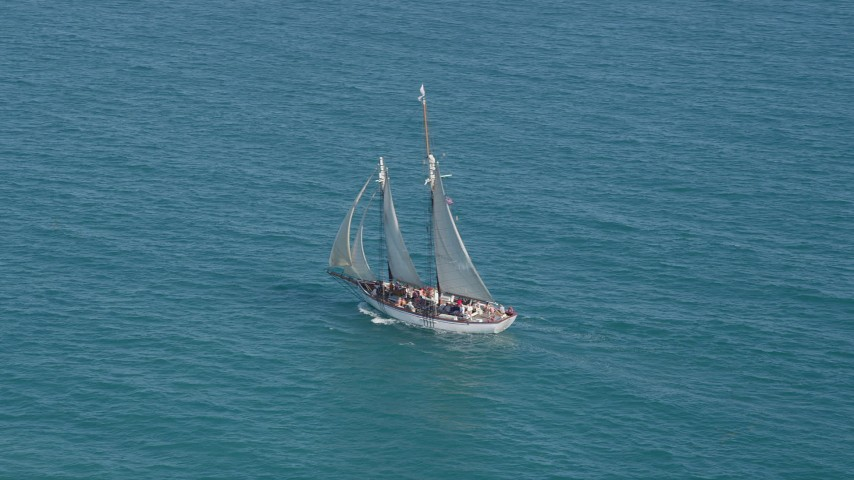 5K stock footage aerial video of circling a sailboat crossing the ocean near Key West, Florida Aerial Stock Footage   AX0026_105