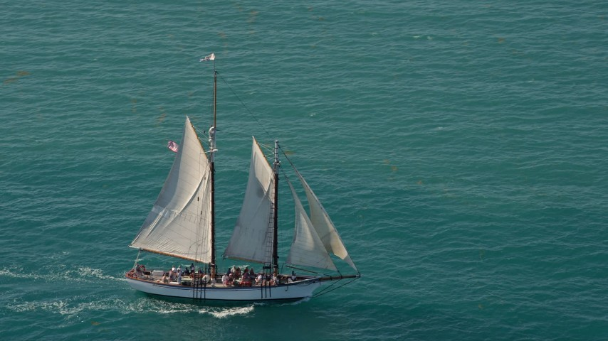 5K stock footage aerial video of a sailboat on the ocean near Key West, Florida Aerial Stock Footage | AX0026_106