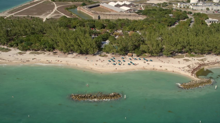5K stock footage aerial video of sunbathers by Fort Zachary Taylor Historic State Park, Key West, Florida Aerial Stock Footage | AX0026_110