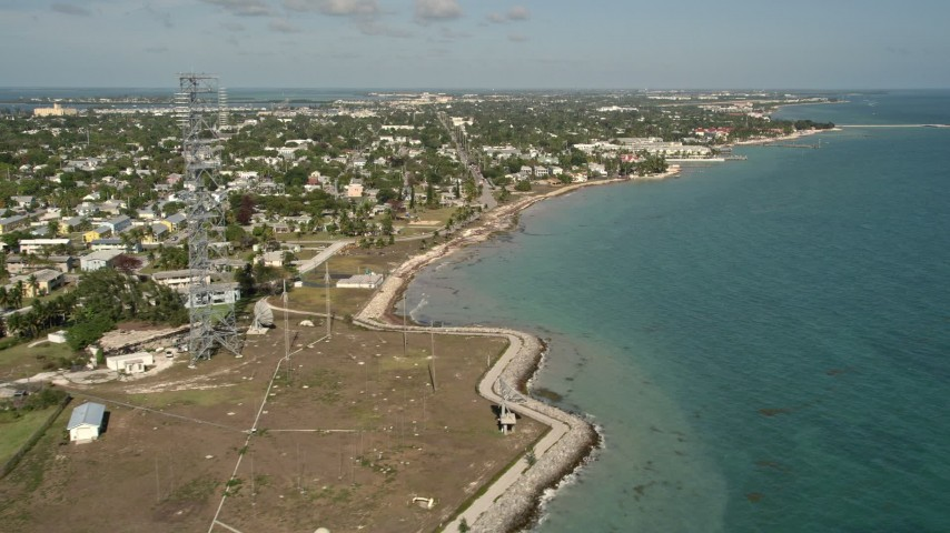 5K stock footage aerial video of island neighborhoods seen from off the coast of Key West, Florida Aerial Stock Footage | AX0026_111