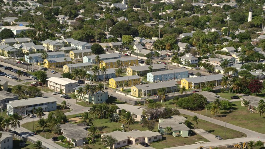 5K stock footage aerial video of flying by barracks at NAS Key West Truman Annex, Key West, Florida Aerial Stock Footage   AX0026_112