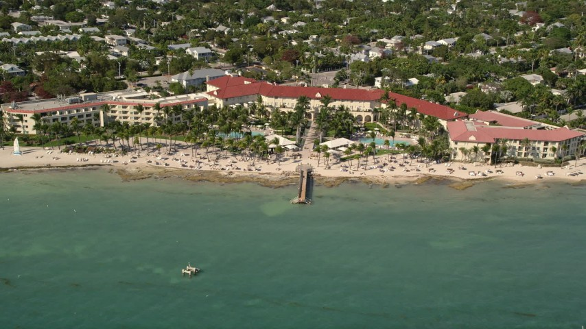 5K stock footage aerial video of Casa Marina, a beachfront hotel in Key West, Florida Aerial Stock Footage | AX0026_115