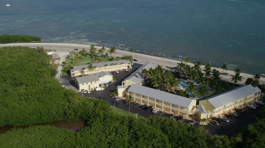 5K stock footage aerial video of approaching Best Western Key Ambassador Resort Inn, Key West, Florida Aerial Stock Footage   AX0027_002