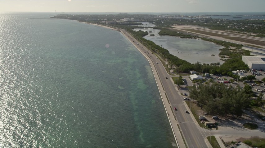5K stock footage aerial video of following South Roosevelt Boulevard, Key West, Florida Aerial Stock Footage | AX0027_003