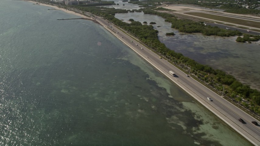 5K stock footage aerial video of flying by South Roosevelt Boulevard, Key West, Florida Aerial Stock Footage   AX0027_004