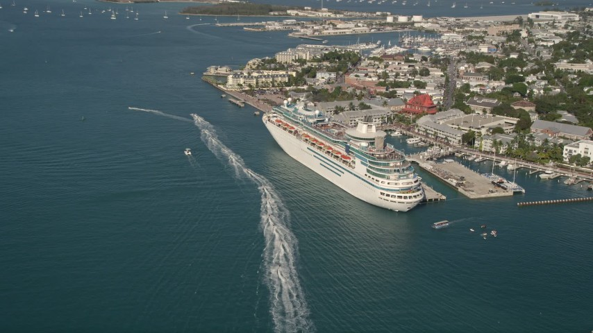 5K stock footage aerial video of approaching docked Royal Caribbean Cruise Ship; Key West, Florida Aerial Stock Footage   AX0027_013