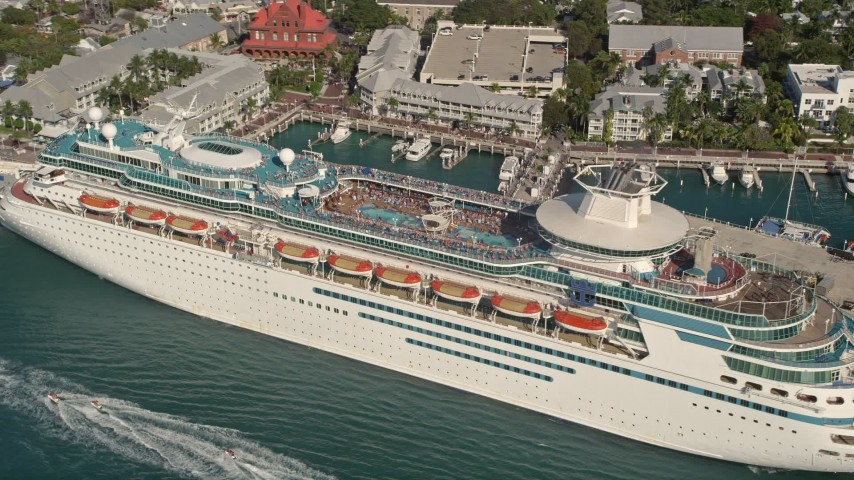 5K stock footage aerial video of flying by a Royal Caribbean cruise ship docked, Key West, Florida Aerial Stock Footage | AX0027_014