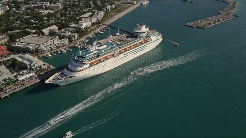 5K stock footage aerial video of flying by Royal Caribbean Cruise Ship docked, Key West, Florida Aerial Stock Footage | AX0027_015