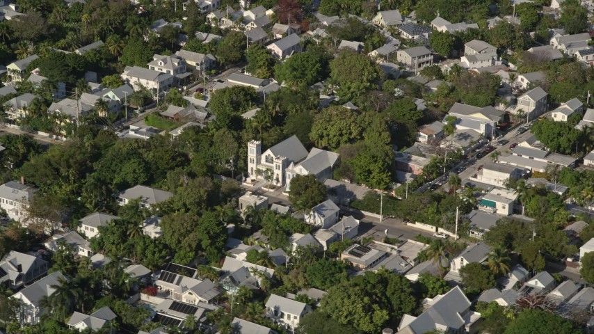 5K stock footage aerial video of a church in a residential neighborhood, Key West, Florida Aerial Stock Footage | AX0027_020