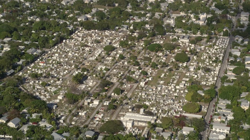 5K stock footage aerial video of approaching Key West Cemetery, Key West, Florida Aerial Stock Footage | AX0027_021