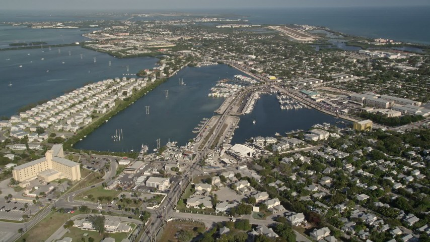 5K stock footage aerial video of flying by Palm Avenue Causeway, Key West, Florida Aerial Stock Footage AX0027_023 | Axiom Images