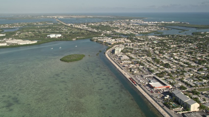 5K stock footage aerial video of flying by North Roosevelt Boulevard, reveal Stock Island, Key West, Florida Aerial Stock Footage | AX0027_029