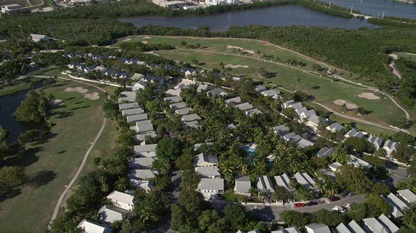 5K stock footage aerial video of flying by neighborhood, Key West Golf Club, Stock Island, Key West, Florida Aerial Stock Footage | AX0027_032