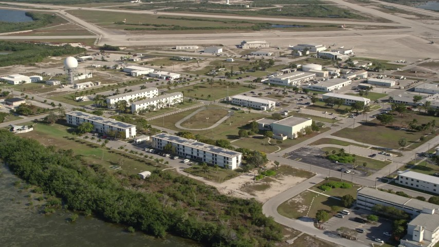 5K stock footage aerial video of flying by Naval Air Station Key West, Key West, Florida Aerial Stock Footage | AX0027_038