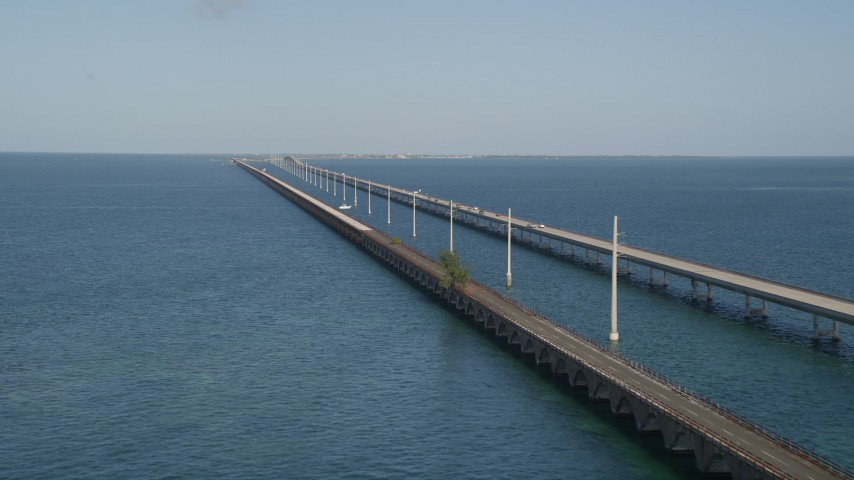 5K stock footage aerial video of approaching light traffic on Seven Mile Bridge, Florida Aerial Stock Footage | AX0027_076