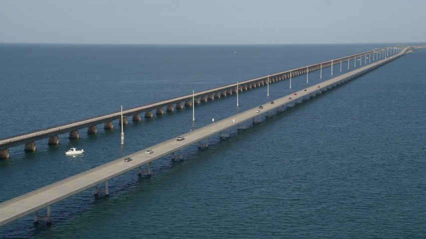 5K stock footage aerial video of flying by light traffic on the Seven Mile Bridge, Florida Aerial Stock Footage | AX0027_078